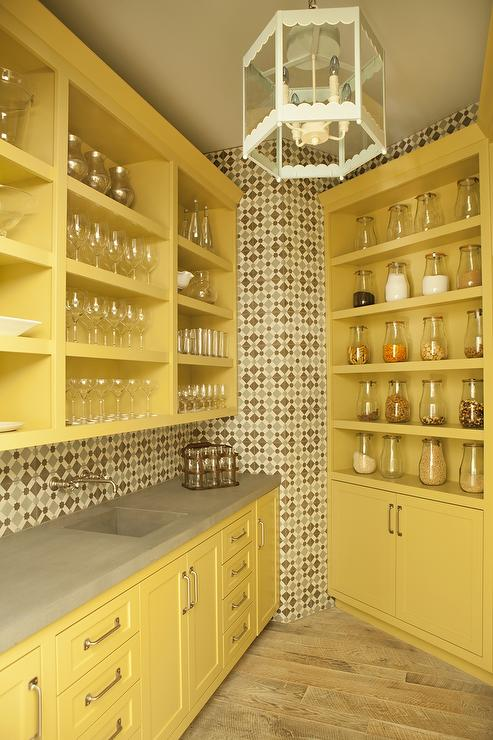 yellow kitchen pantry boasts mustard yellow shaker cabinets