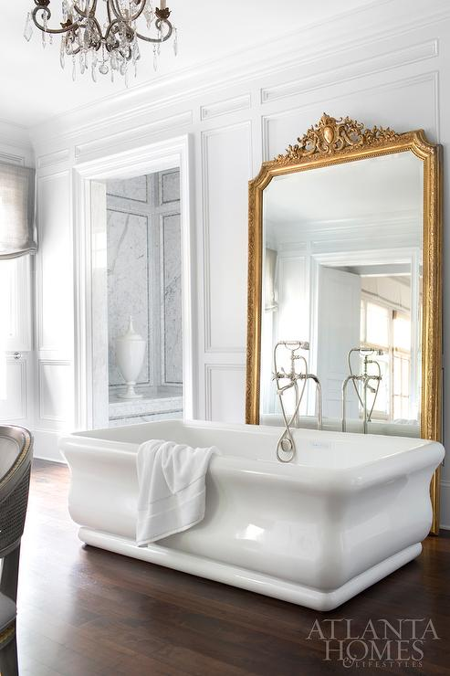 Freestanding Tub In Front Of Gold Leaf Baroque Mirror
