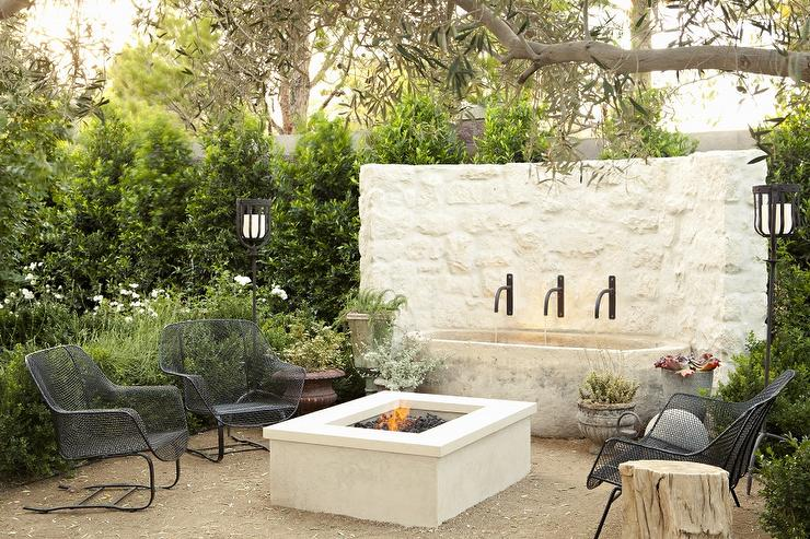 Amazing Patio With Curved White Stone Outdoor Water Fountain