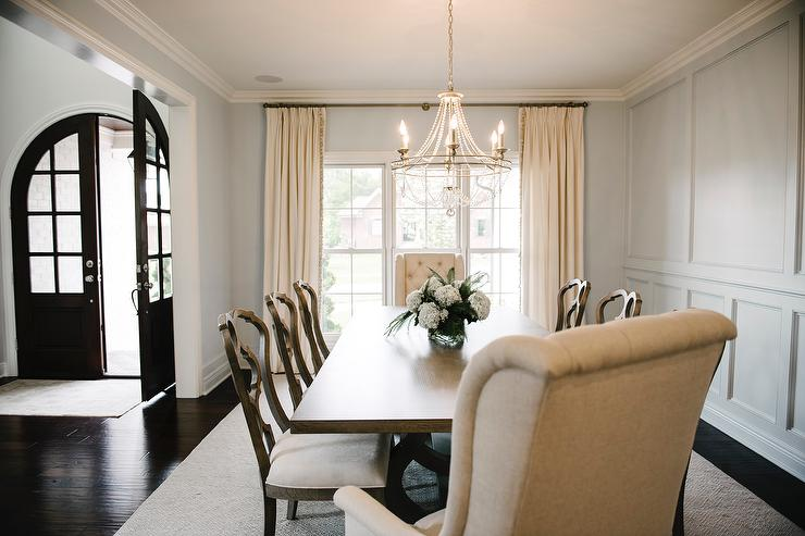 Dining Room Interior Design By Kerry Spears Interiors Featuring Upholstered Host Chairs And Floor To Ceiling Wainscoting On The Walls