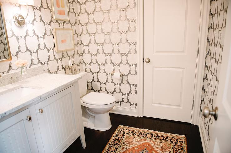 powder room interior design by Kerry Spears Interiors featuring cheetah wallpaper and orange accents. Cheetah Bathroom Wallpaper Design Ideas