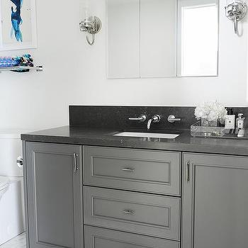White bathroom with dark gray floor design ideas - Black marble bathroom countertops ...