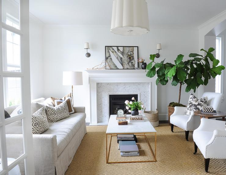 Exceptional White And Brown Living Room Features A Barbara Barry Simple Scallop Pendant  Illuminating A Natural Linen Skirted Sofa Lined With Black And White  Pillows As ...