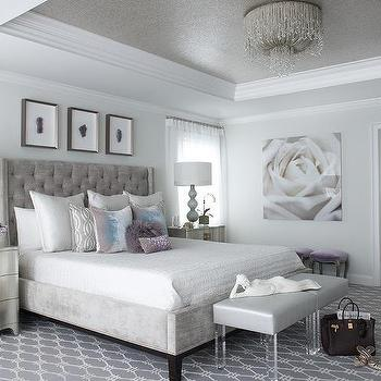 silver gray headboard supporting a bed covered in white hotel bedding