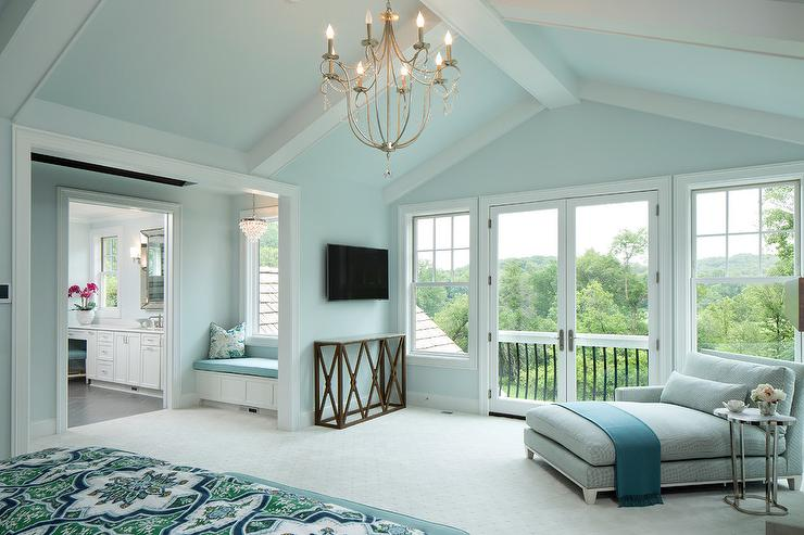 Blue Master Bedroom With Gray Chaise Lounge And Marble Quatrefoil Accent  Table