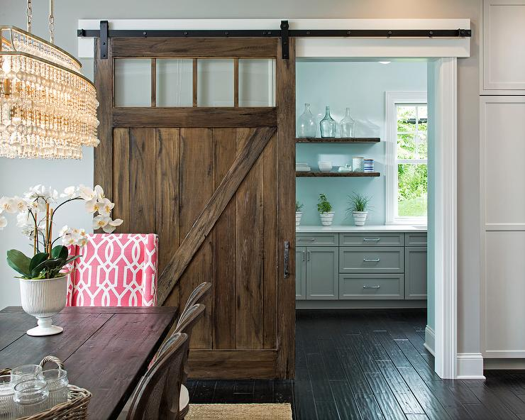 Kitchen Pantry With Salvaged Wood Barn Door On Rails