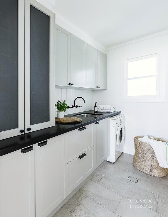Light Gray Laundry Room Cabinets With Mesh Cabinet Doors
