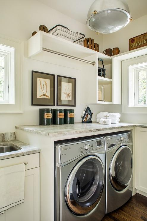 Cottage Laundry Room With Tension Drying Rod Over Enclosed Washer And Dryer