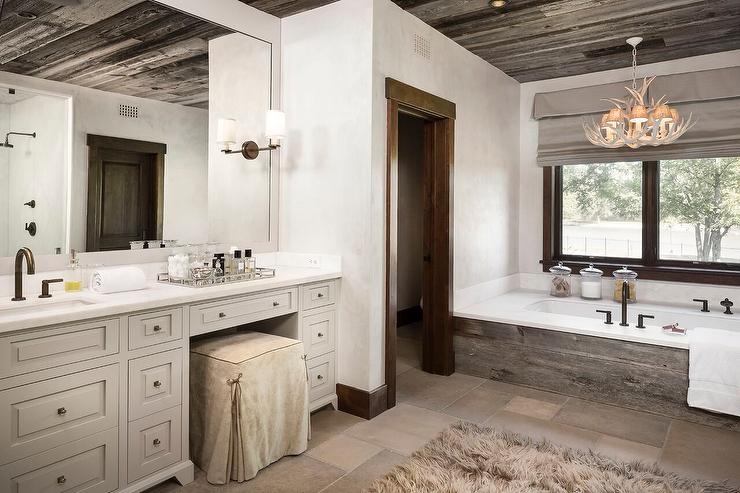 Country Style Bathroom with Faux Antlers Chandelier Over Plank Tub ...