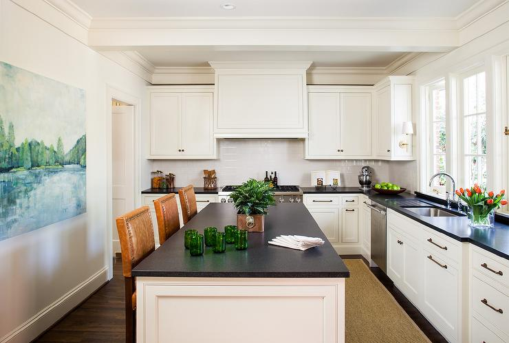 Ivory Shaker Cabinets With Honed Black Marble Counter And