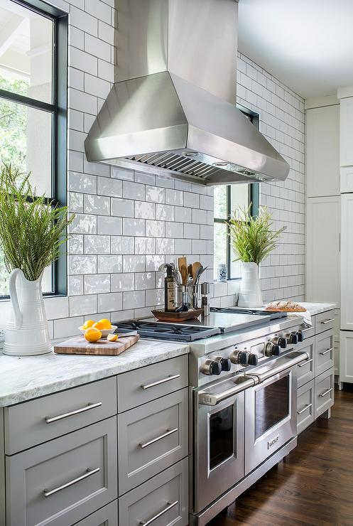 Light Gray Kitchen Cabinets With White And Gray Granite
