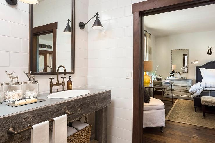 ... Functional Library Wall Lights mounted on large white subway tiles  framing a brass vanity mirror fixed above a reclaimed wood double vanity  topped with ... - Country Style Bathroom With Reclaimed Wood Dual Vanity - Country