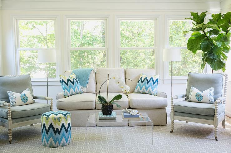 Ivory And Blue LIving Room With Spindle Chairs Turquoise Paisley Pillows