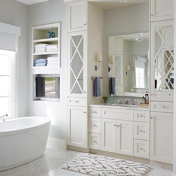 white and gray bathroom tv niche across from bathtub