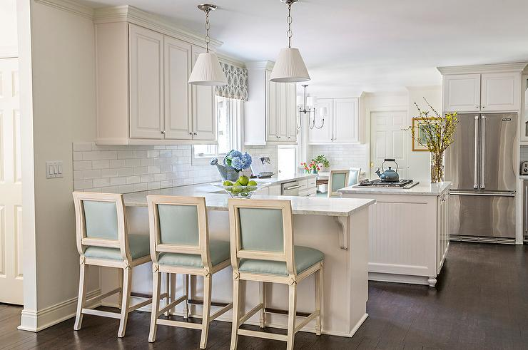 Kitchen Peninsula With Blue Leather Counter Stools And White Pleated - Pendant lighting over kitchen peninsula