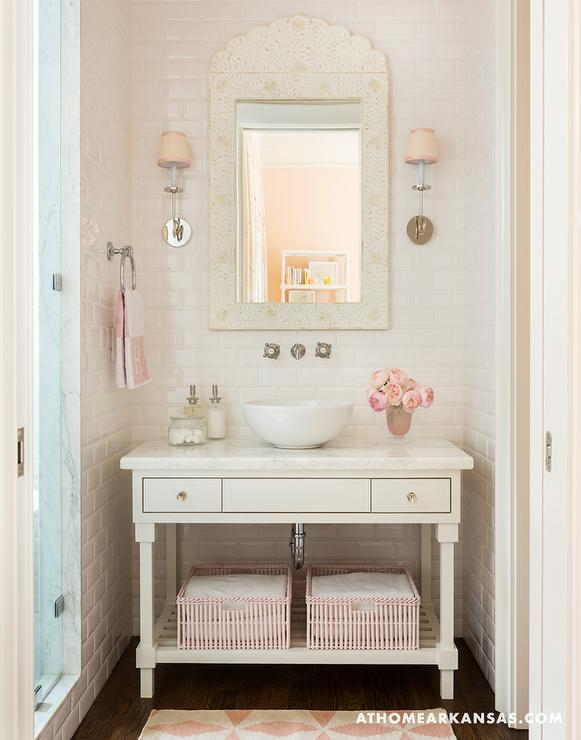 white and pink girl bathroom with pink hermes hand towel
