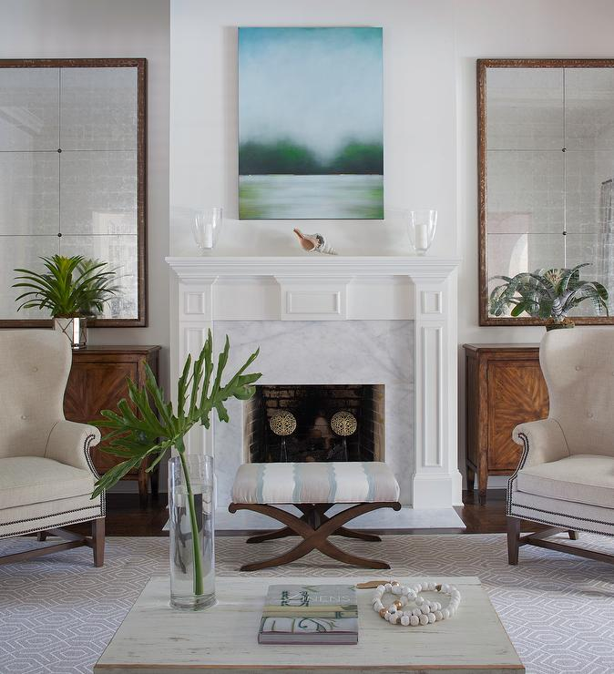 LIving Room Fireplace Flanked By Mirrors And Cabinets