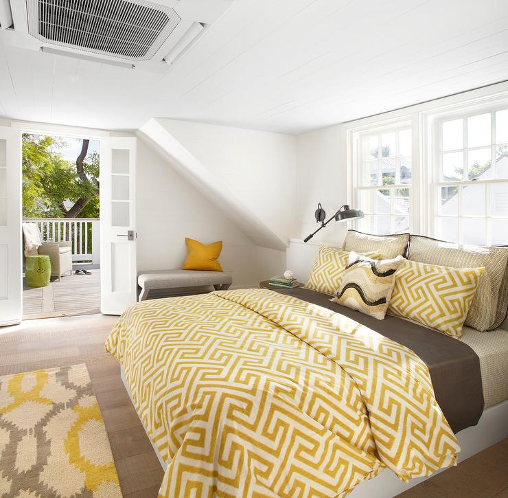 built in bed with yellow and brown bedding