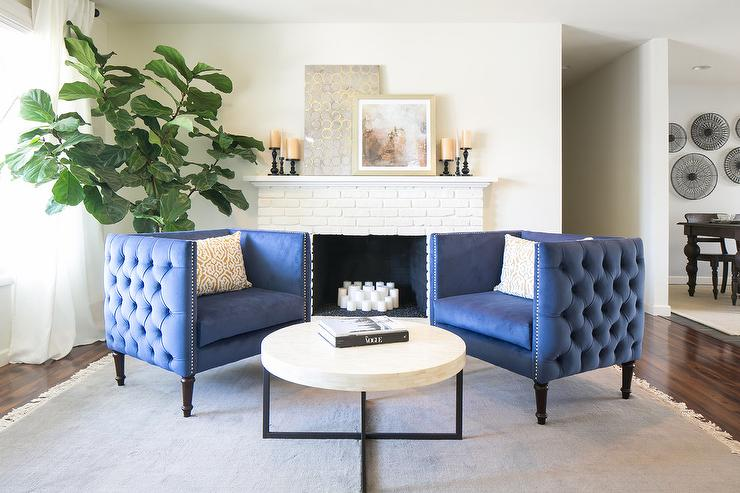 Blue Tufted Accent Chairs with White Brick Fireplace - Transitional ...