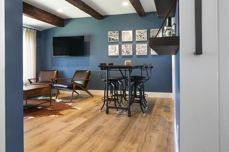 Brown And Blue Man Cave With Brown Leather Chairs And Brown Cowhide Rug