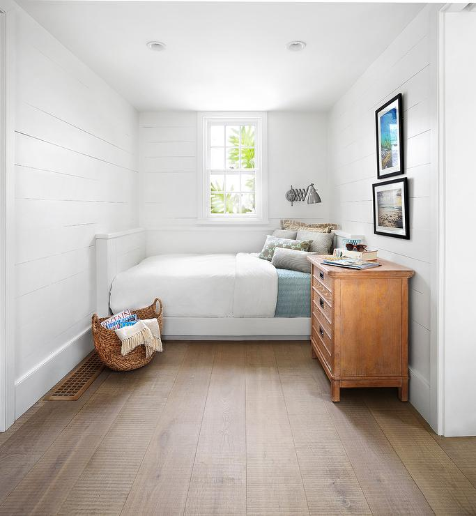 Simple White Boyu0027s Bedroom Features A Nickel Accordion Wall Sconce Lighting  A White Built In Shiplap Bed Dressed In White And Blue Bedding Topped With  Gray ...