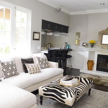 White And Black LIving Room With Black Built In Bar