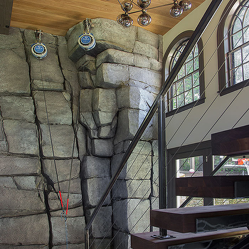 Foyer And Game Room Combo With Gray Stone Climbing Wall