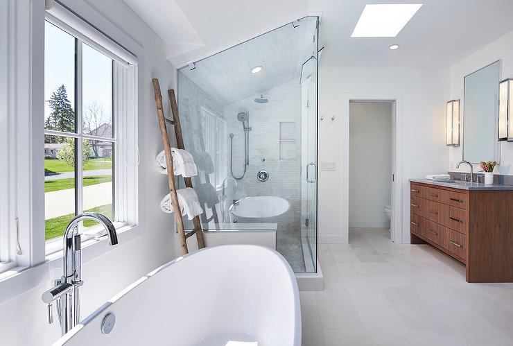 Amazing master bath features an oval freestanding tub and a modern  gooseneck tub filler placed under a window with a rustic towel ladder  between the tub and. Master Bath Towel Ladder Design Ideas
