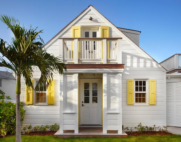 White Cottage Home With Yellow Shutters Cottage Home Exterior