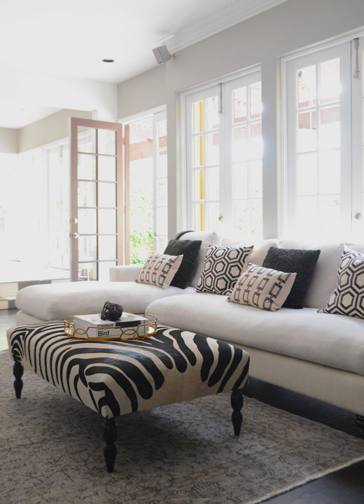 White Sofa With Chaise Lounge And Black And White Zebra Bench Coffee Table