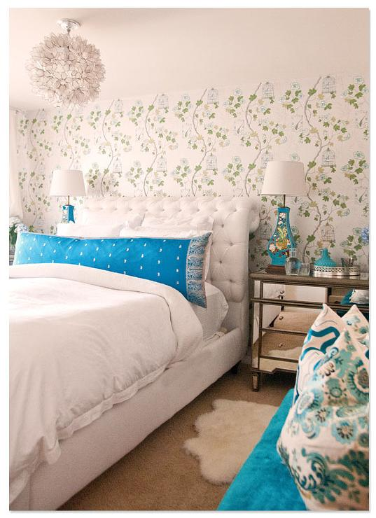 White And Turquoise Bedroom With Mirrored Dressers As Nightstands