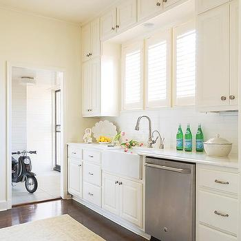 Beau Ivory Kitchen Cabinets With Farm Sink And Louvered Window Shutters