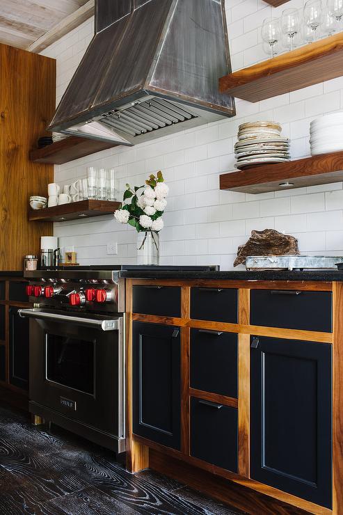 Industrial Kitchen With Dark Steel Vent Hood