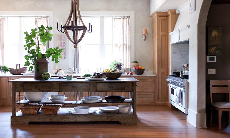 european style kitchen with wood wine barrel chandelier and rustic kitchen island