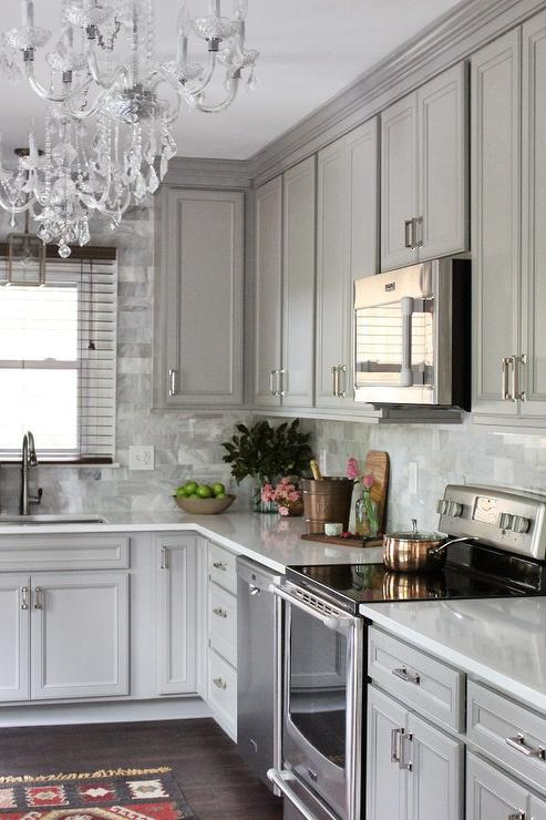 Gray KItchen With Gray Marble Backsplash Tiles Transitional Kitchen - Gray cabinets with marble countertops