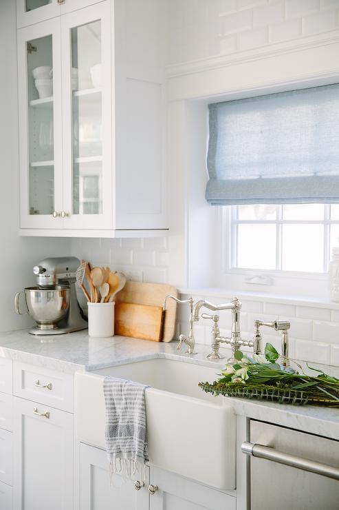 ivory kitchen cabinets with beveled subway tile backsplash cottage