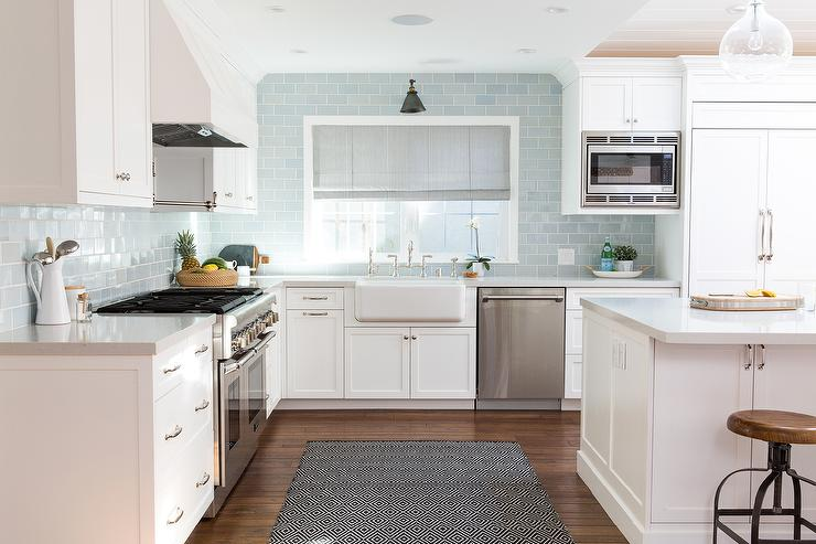 White Kitchen with Blue Backsplash and Roman Shade Transitional