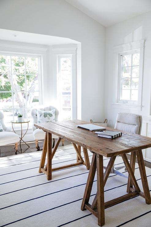 bay window desk home office modern. lovely home office features a reclaimed wood sawhorse desk paired with an oatmeal linen rolling task chair placed atop white rug dark blue thin bay window modern r
