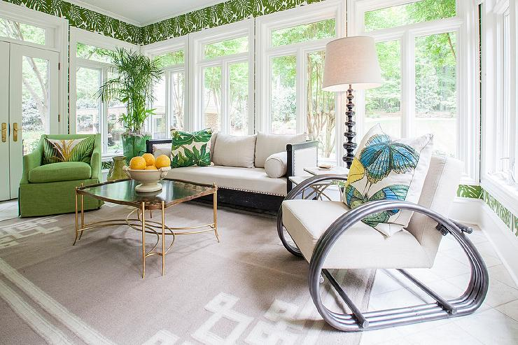green sunroom with black distressed sofa - Distressed Living Room 2016