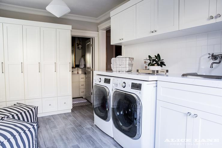 White Laundry Room With Wood Like Floor Tiles