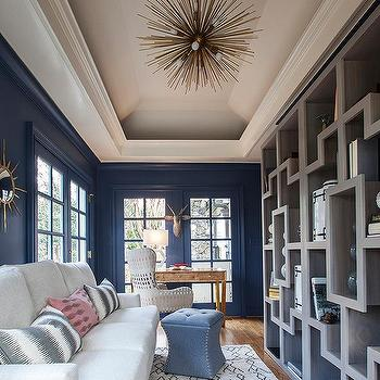 Long Blue Living Room With Gray Built In Shelves