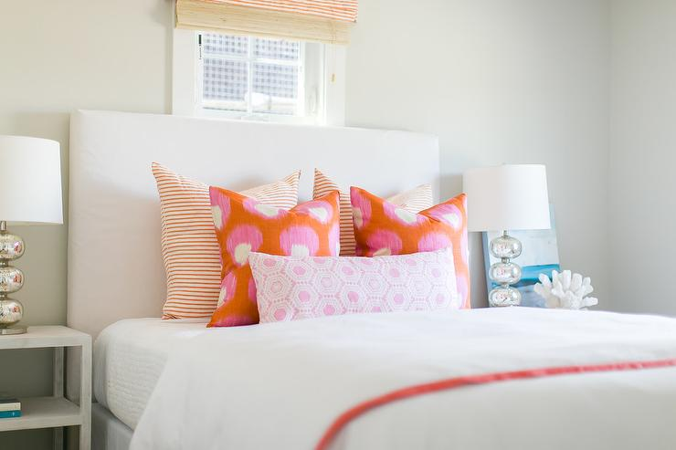 White Headboard with Orange and Pink Pillows - Transitional - Bedroom
