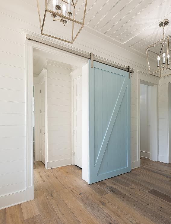 Powder blue barn door on rails transitional kitchen for Barn door pictures