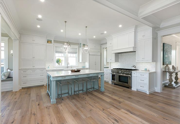 White Cabinets With Powder Blue Kitchen Island And Sawn Oak Wood Floors Transitional Kitchen
