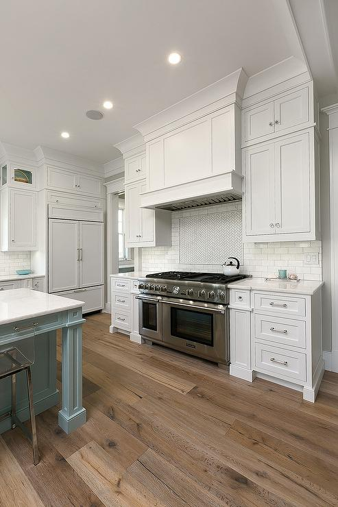 White kitchen cabinets with sawn oak wood floors for White cabinets white floor