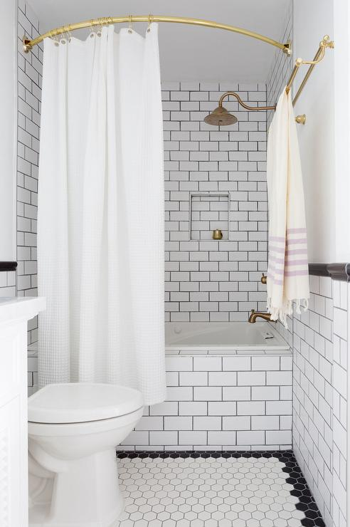 Tub Clad In White Subway Tiles And Black Grout