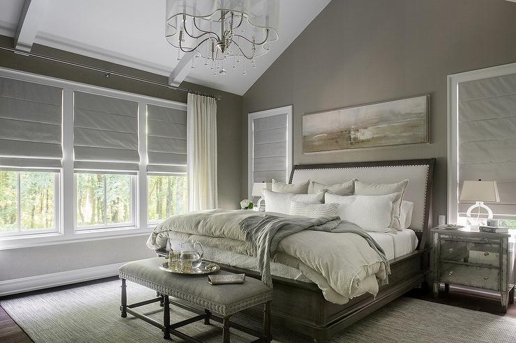taupe and gray bedroom with mirrored nightstands