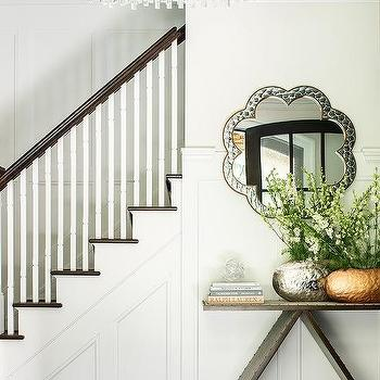 Foyer With Oval Scalloped Chandelier And Wood And Fabric Console Table