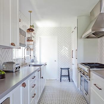 White And Grey Galley Kitchen white herringbone kitchen backsplash tiles with gray grout