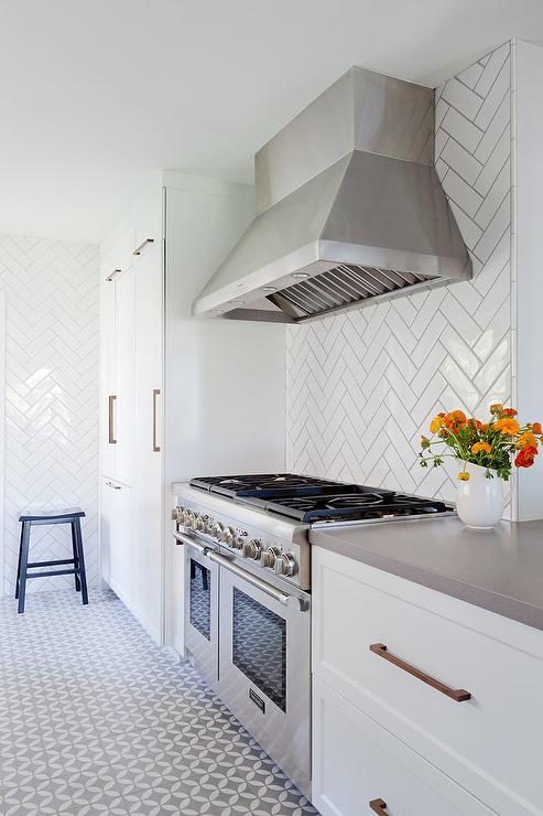 White galley style kitchen with herringbone backsplash for White kitchen floor tiles